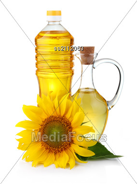 Jug And Bottle Of Sunflower Oil With Flower Stock Photo