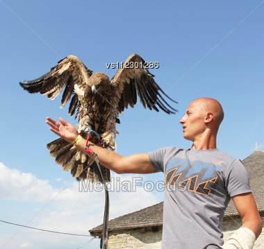 KAMYANETS-PODILSKY, UKRAINE- JUNE 2: Undefined Young Man With Hunting Eagle During Forpost (The Outpost) Festival Of Medieval Culture On June 2, 2012, Kamyanets-Podilsky, Ukraine Stock Photo