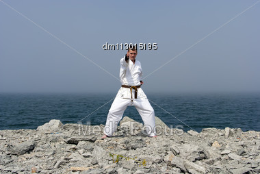 Karate On The Shores Of The Misty Sea Stock Photo