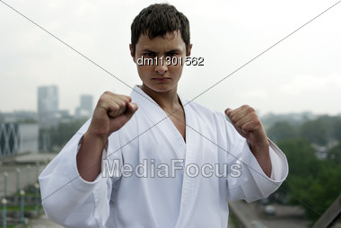 Karate Poses Against The Backdrop Of The City Stock Photo