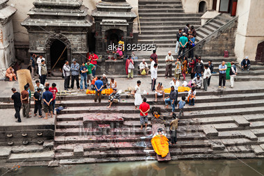 KATHMANDU - APRIL 15: Cremation Ceremony Along The Holy Bagmati River At Pashupatinath Temple Complex, April 15, 2012 In Kathmandu, Nepal. This Is The Most Sacred Place To All Hindus In Nepal Stock Photo