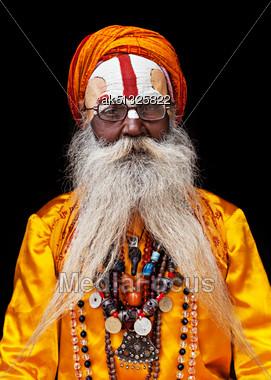 KATHMANDU - APRIL 15: Sadhu At Pashupatinath Temple In Kathmandu, Nepal On April 15, 2012. Sadhus Are Holy Men Who Have Chosen To Live An Ascetic Life And Focus On The Spiritual Practice Of Hinduism Stock Photo