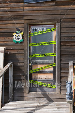 Stock photo keep out danger tape haunted house door for 13 door haunted house