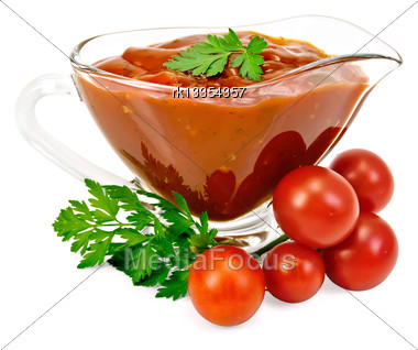 Ketchup In A Glass Gravy Boat With Tomatoes And Parsley Isolated On White Background Stock Photo