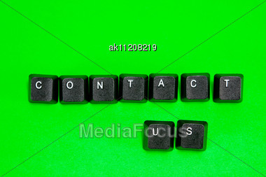 Keyboard Plastic Keys With Words Contact Us Over Green Background Stock Photo