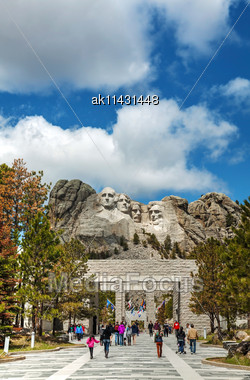 KEYSTONE, SD - MAY 10: Mount Rushmore Monument With Tourists On May 10, 2014 Near Keystone, SD. It's A Sculpture Carved Into The Granite Features 60-foot Sculptures Of The Heads Of 4 US Presidents Stock Photo