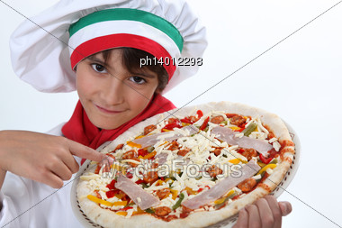 Kid Dressed As Pizza Chef Stock Photo