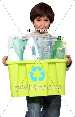 Kid Holding Recycling Tub Full Of Empty Plastic Bottles Stock Photo