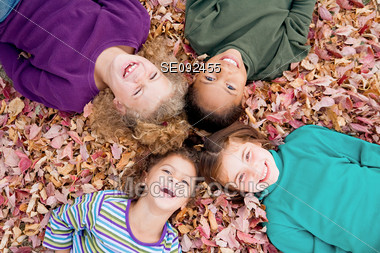 Kids in the Fall Leaves Stock Photo