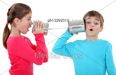 Kids Playing With Tins Stock Photo