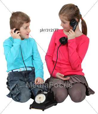 Kids Using Old-fashioned Telephone Stock Photo