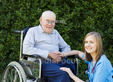 Kind Doctor Helping Patient With Alzheimer's Disease Stock Photo