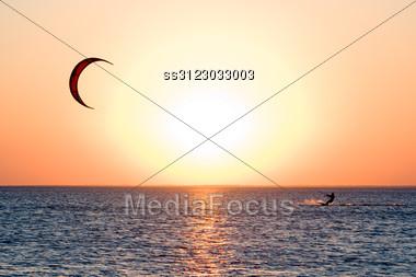 Kitesurfer On A Gulf On A Sunset Stock Photo