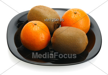 Kiwi And Mandarin On A Black Plate Stock Photo