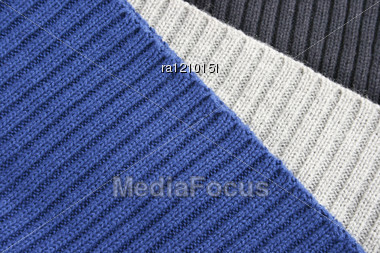 Knitted Colorful Wool Cloths As A Background. Stock Photo