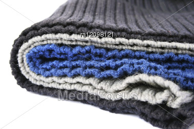 Knitted Colorful Wool Cloths On White Background. Stock Photo