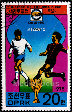 "KOREA - CIRCA 1978: A Postage Stamp Shows The Soccer Players With Inscription ""Chile 1962"", Series ""History Of World Cup"", Circa 1978 Stock Photo"