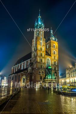 Krakow Old City At Night St. Mary's Church At Night. Krakow Poland Stock Photo