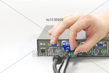 KVM (keyboard, Video And Mouse) Switch And A Human Hand With An VGA (Video Graphics Array) Connector Stock Photo