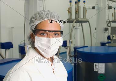 Laboratory Technician Wearing Mask Stock Photo