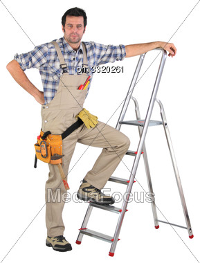 Laborer Leaning On A Ladder Isolated On White Background Stock Photo