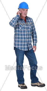 Laborer With Mobile Phone Stock Photo