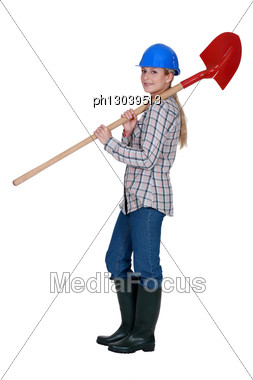 Labourer Carrying A Spade Stock Photo