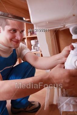 Labourer Fixing Sink Stock Photo