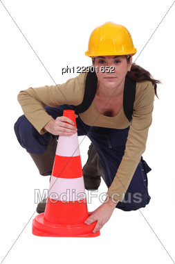 Labourer Placing A Traffic Pylon Stock Photo
