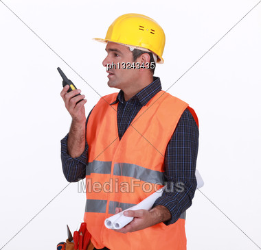 Labourer Speaking Into A Walkie-talkie Stock Photo