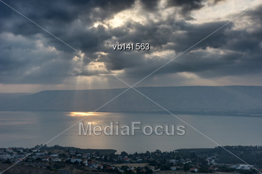 Lake Kinneret In The Morning, Sun Rays Are Shining Through The Clouds Stock Photo