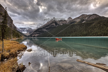 Lake Louise Glacier Canoe And Emerald Color Stock Photo