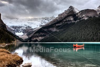 Lake Louise Glacier Canoe And Emerald Color Stock Photo