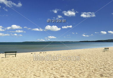 Lake Michigan Beaches With Bench And Cloudy Sky Stock Photo
