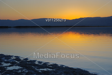 Landscape Dead Sea Shortly Before Dawn, Salt, Water And The Jordanian Mountains In The Background Stock Photo