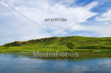 Landscape With River And Green Hills Background Stock Photo