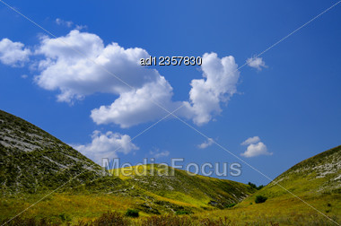 Landscape With Green Hills Background Stock Photo