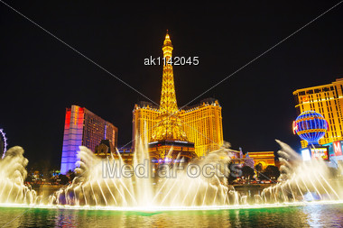 LAS VEGAS - APRIL 18: Fountains Show In Las Vegas On April 18, 2014 In Las Vegas, Nevada. It's The Most Populous City In The State Of Nevada And The County Seat Of Clark County Stock Photo