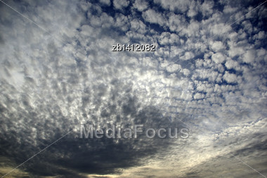 Late Afternoon Deep Blue Sky With Clouds, White To Deep Grey Stock Photo