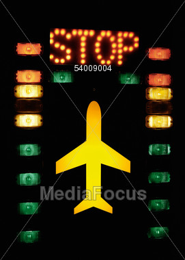 Light Ads With Aircraft And Stop, Colored Buttons, Tower, Airport Stock Photo