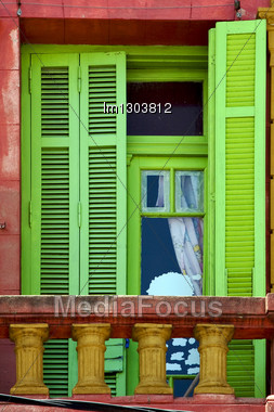 Light Green Wood Venetian Blind And A Red Terrace Wall In La Boca Buenos Aires Argentina Stock Photo
