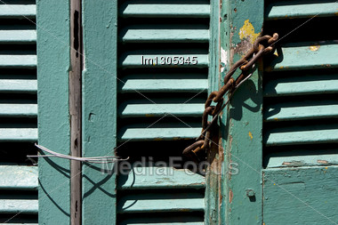 Light Green Wood Venetian Blind And A Rusty Chain In La Boca Buenos Aires Argentina Stock Photo