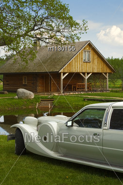 Light Limousine In The Meadow At Homestead Stock Photo