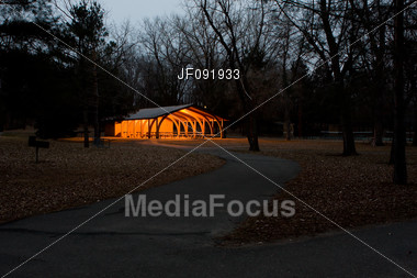 Lighted Shelter In The Park Early In The Morning Stock Photo