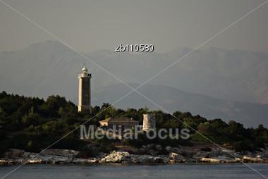 Lighthouse At Greek Island Of Kefalonia At Summer Evening Sunset Stock Photo