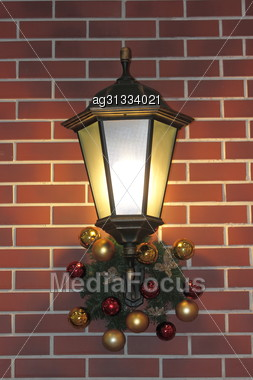 Lighting Fixture In The Old Style Decorated With Colorful Balls And Christmas Items Stock Photo