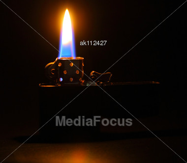 Lighting Flame On Dark Background. Closeup. Studio Photography Stock Photo
