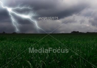 Lightning Across The Countryside Field. Summer Stock Photo