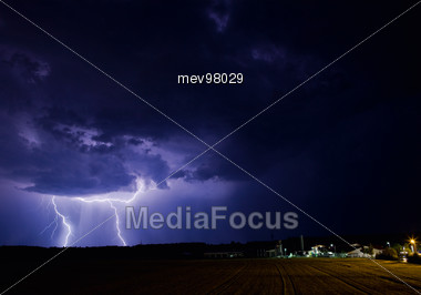 Lightning Flashes In The Night Sky Stock Photo