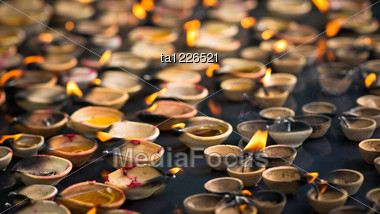 Lights Of Oil Candles In Small Cups Stock Photo